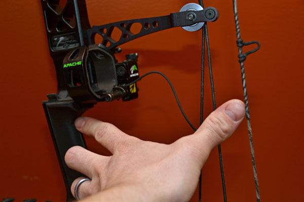 A bowhunter indicates brace height as the distance between the deepest part of the grip and the bow's string.
